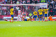 Lyle Taylor of Charlton Athletic (9) scores a goal to make the score 1-0 during the EFL Sky Bet League 1 play off first leg match between Doncaster Rovers and Charlton Athletic at the Keepmoat Stadium, Doncaster, England on 12 May 2019.