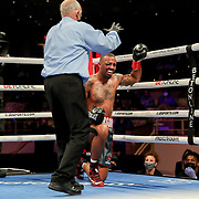 HOLLYWOOD, FL - APRIL 17:  Christopher Pearson fails to beat the count against Carlos Gongora during the IBO World Super Middleweight title fight at Seminole Hard Rock Hotel & Casino on April 17, 2021 in Hollywood, Florida. (Photo by Alex Menendez/Getty Images) *** Local Caption *** Carlos Gongora; Christopher Pearson