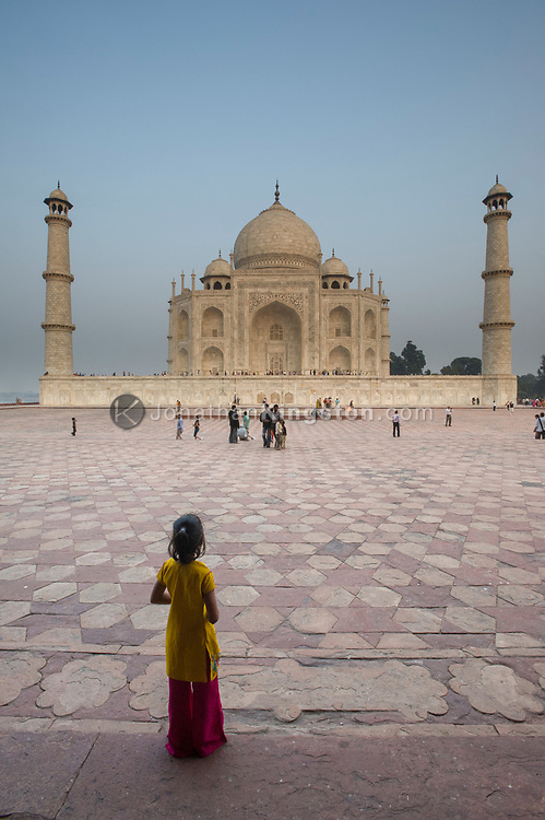 A young girl looks at the Taj Mahal, Agra, India.