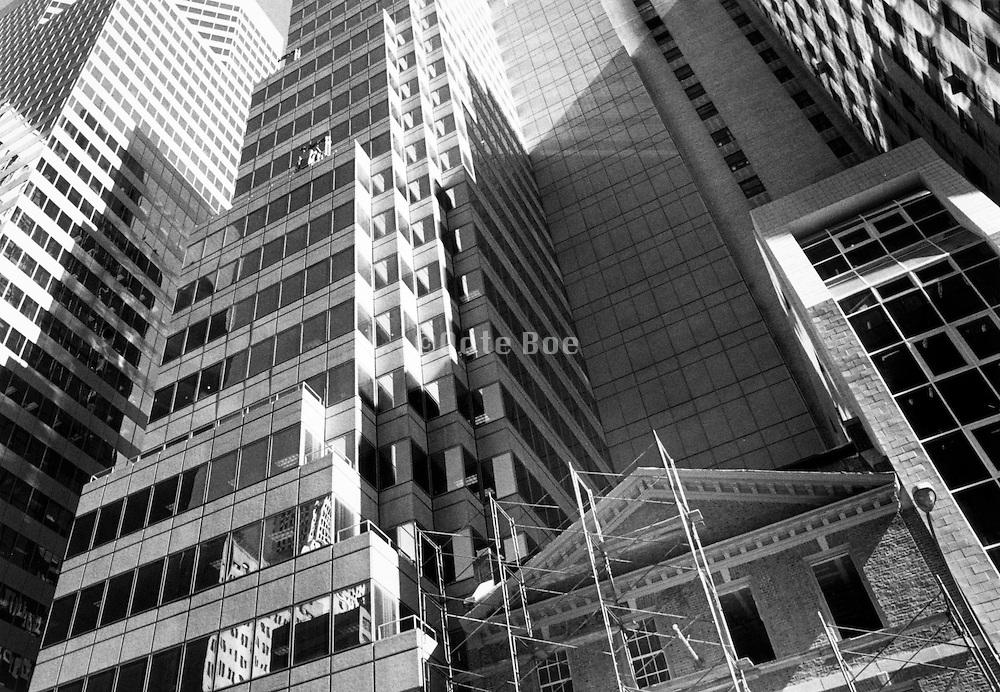 Upwards few of an old building between high rise, New York City, Manhattan