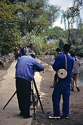 Photographer Using Old Camera