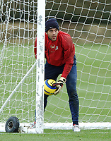 Photo: Javier Garcia/Back Page Images Mobile +447887 794393<br />Arsenal FC UEFA Champions League Training, London Colney, 06/12/04<br />Manuel Almunia practices picking the ball out of the back of the net