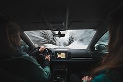 Das Steirische Ennstal ist eine der Großlandschaften der Steiermark und umfasst den Mittellauf der Enns. Der politische Bezirk Liezen entspricht in etwa dem Steirischen Ennstal. Im Bild ein Auto auf der Fahrt durch einen verschneiten Wald, aufgenommen am 28.12.2019, Schladming, Oesterreich // The Styrian Enns Valley is one of the major landscapes in Styria and includes the middle course of the Enns. The political district of Liezen roughly corresponds to the Styrian Enns Valley. In the picture a car driving through a snowy forest, Schladming, Austria on 2019/12/28. EXPA Pictures © 2020, PhotoCredit: EXPA/ Florian Schroetter