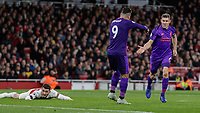 Football - 2018 / 2019 Premier League - Arsenal vs. Liverpool<br /> <br /> James Milner (Liverpool FC) is congratulated by Roberto Firmino (Liverpool FC) as Sead Kolasinac (Arsenal FC) lies flat on the pitch at The Emirates.<br /> <br /> COLORSPORT/DANIEL BEARHAM