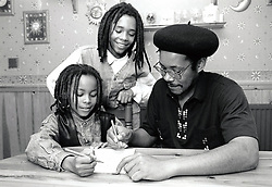 Father helping children with homework / drawing UK 1990s