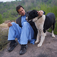 Imran Khan with his dog Moutoo in the grounds of his house which sits on a hill overlooking Islamabad.<br /> <br /> Cricketer Imran Khan made his Test debut against England in 1971. He became captain of the Pakistan team in 1982 and lead them to World Cup victory in 1992 after which he retired.<br /> <br /> Imran Khan established the Tehrik-e-insaaf (or Moverment for Justice) in 1996. Through Tehrik-e-insaaf, Khan has demanded that the Pakistan government make institutional reforms to address corruption and end the present dictatorship. Khan would like a more equitable distribution of resources in Pakistan, the granting key civil liberties and an increas in public service spending. He is particularly scathing of the relationship between President Musharraf and US President Bush.<br /> <br /> Imran Khan became a Member of the Pakistani Parliament for Mianwali, Panjab, in the October 2002 elections.<br /> <br /> Photo: Tom Pietrasik<br /> Islamabad Pakistan<br /> 27th January 2006