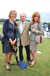 Left to right, VISCOUNTESS COWDRAY, MARTYN BROWN and STEFANIE POWERS at the 2011 Veuve Clicquot Gold Cup Final at Cowdray Park, Midhurst, West Sussex on 17th July 2011.