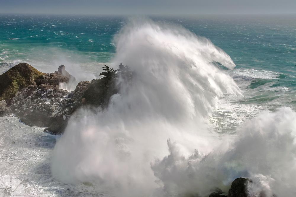 Crashing wave on McWay Cove headland, Julia Pfeiffer Burns State Park, Big Sur Coast, California