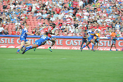 070418 Emirates Airlines Park, Ellis Park, Johannesburg, South Africa. Super Rugby. Lions vs Stormers. Stormers Damian Willemse tries to tackle Madosh Tambwe on his way to scoring one of four tries.<br />Picture: Karen Sandison/African News Agency (ANA)