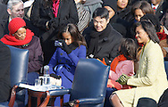 Malia Obama takes a picture at the swearing in ceremony during the Inauguration on January 20, 2009.  Photograph:  Dennis Brack
