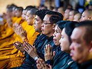 25 OCTOBER 2017 - BANGKOK, THAILAND: Monks and lay people pray for the late king during the funeral for Bhumibol Adulyadej, the Late King of Thailand. He died in October 2016 and was cremated during an ornate five day funeral on 26 October 2017. He reigned for 70 years and was Thailand's longest serving monarch.         PHOTO BY JACK KURTZ