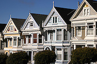 """Victorians at Alamo Square - Painted Ladies is a term used for Victorian and Edwardian buildings painted in three or more colors that enhance their architectural details.  About 48,000 houses in the Victorian and Edwardian styles were built in San Francisco between 1849 and 1915 with the change from Victorian to Edwardian occurring on the death of Queen Victoria in 1901, and many were painted in bright colors.  One of the best known groups of """"Painted Ladies"""" is the row of Victorian houses on Steiner Street bordering Alamo Square park in San Francisco. This block appears very frequently in media photographs of the city."""