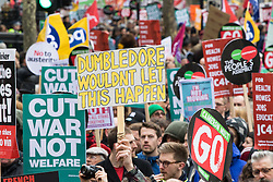 """London, April 16th 2016. A protester's banner channels the Harry Potter characters as thousands of people supported by trade unions and other rights organisations demonstrate against the policies of the Tory government, including austerity and perceived favouring of """"the rich"""" over """"the poor""""."""