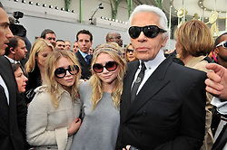 Mary-Kate and Ashley Olsen with Karl Lagerfeld attend the Chanel Fall-Winter 2008-2009 Ready-to-Wear collection show, held at the Grand Palais, in Paris, France on February 29, 2008. Photo by Guignebourg-Nebinger-Orban-Taamallah/ABACAPRESS.COM