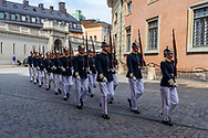 Stockholm, Sweden -- July 18, 2019. Swedish soldiers march in their ceremonial uniforms for the changing of the guard.