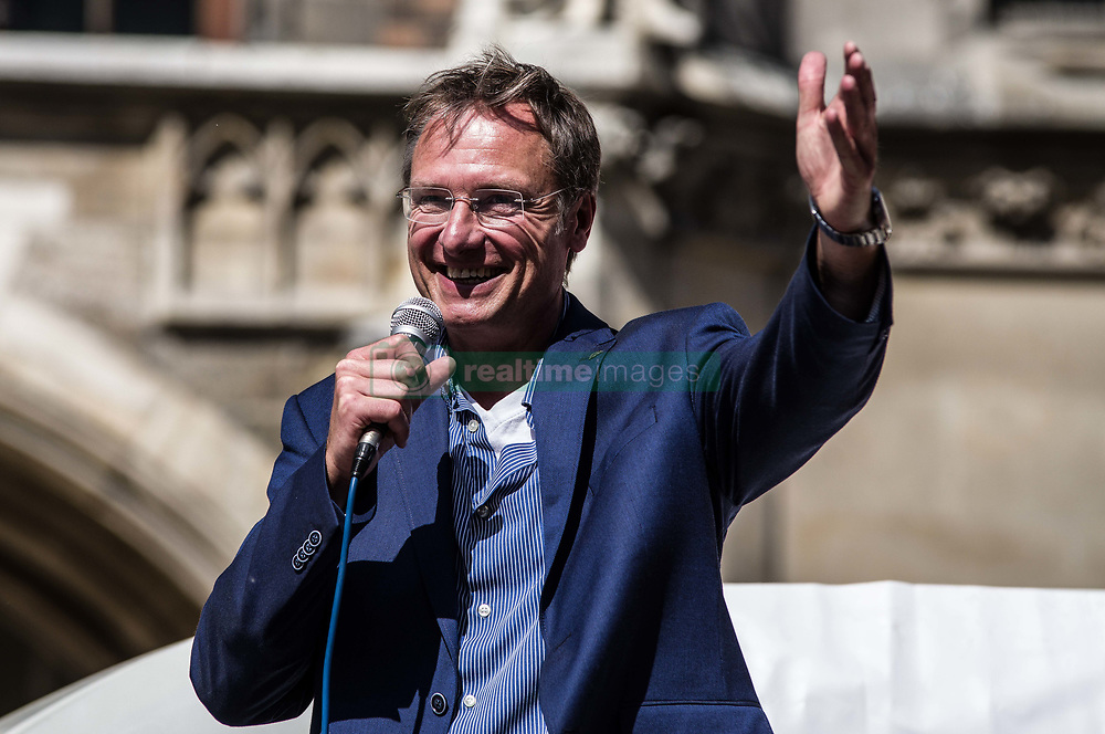 """April 28, 2018 - Munich, Bavaria, Germany - Michael Stürzenberger (Sturzenberger). Inviting Pegida founder Lutz Bachmann Pegida Dresden returned to Munich for a repeat of last month's march through one of the most-traveled portions of the city.  Last month, just a few hours after Bachmann's appearance in Munich, he was arrested at London-Stansted airport and subsequently deported back to Germany due to attempting to make an appearance at a right-extremist event at Hyde Park.  While in detention, he live-streamed videos and photos of the facility, leading to criminal charges.  There were less than 100 demonstrators for Pegida and several hundred against, most notably, youths..The city of Munich has two Pegida factions: the """"Munich"""" faction which has been called the """"the weaponized arm of Pegida"""" due to the group allegedly trying to amass firearms through the operation of a shooting club.  The group's leader, Heinz Meyer, has been under terrorism monitoring since 2012 and has numerous neo-nazis and right-wing terrorists under its followers.  """"Pegida Dresden"""" is effectively Pegida Nuremburg, who is attempting to take the greater role in Munich.  Sturzenberger is under Verfassungsschutz monitoring for islamophobia and incitement.  In 2015, he was pushed out of Pegida by Meyer, after which he began working with numerous far-right groups across Germany, eventually winning Bachmann's favor and becoming a regular speaker in the extreme-right city of Dresden.  Pegida groups throughout Germany are associated with right-extremists, right-wing terrorists, and attacks on the media. (Credit Image: © Sachelle Babbar via ZUMA Wire)"""