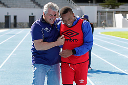 (left to right) Club owner John Comitis shares a happy moment with Lehlohonolo Majoro as he congratulates him on his birthday after the team's morning training session during the Cape Town City FC Media Open Day held at the Greenpoint Athletics Stadium in Cape Town, Western Cape, South Africa on the 19th August 2016.<br /> <br /> Photo by: Mark Wessels / Real Time Images.