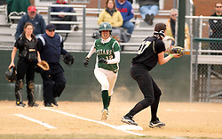 30 March 2013:  Courtney Martin batting during an NCAA Division III women's softball game between the DePauw Tigers and the Illinois Wesleyan Titans in Bloomington IL<br /> <br /> Umpire is Jay MacDaniels of Pekin IL