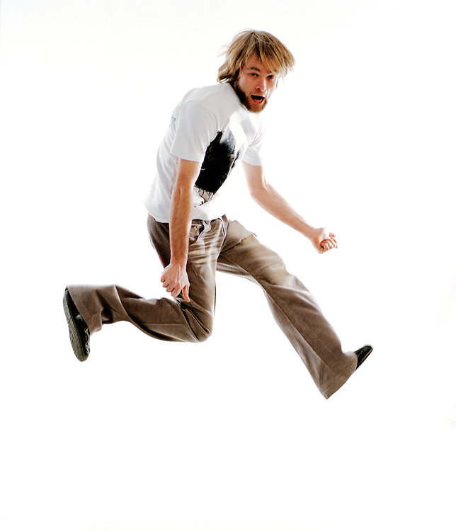 Portrait of an energetic Man jumping in the air