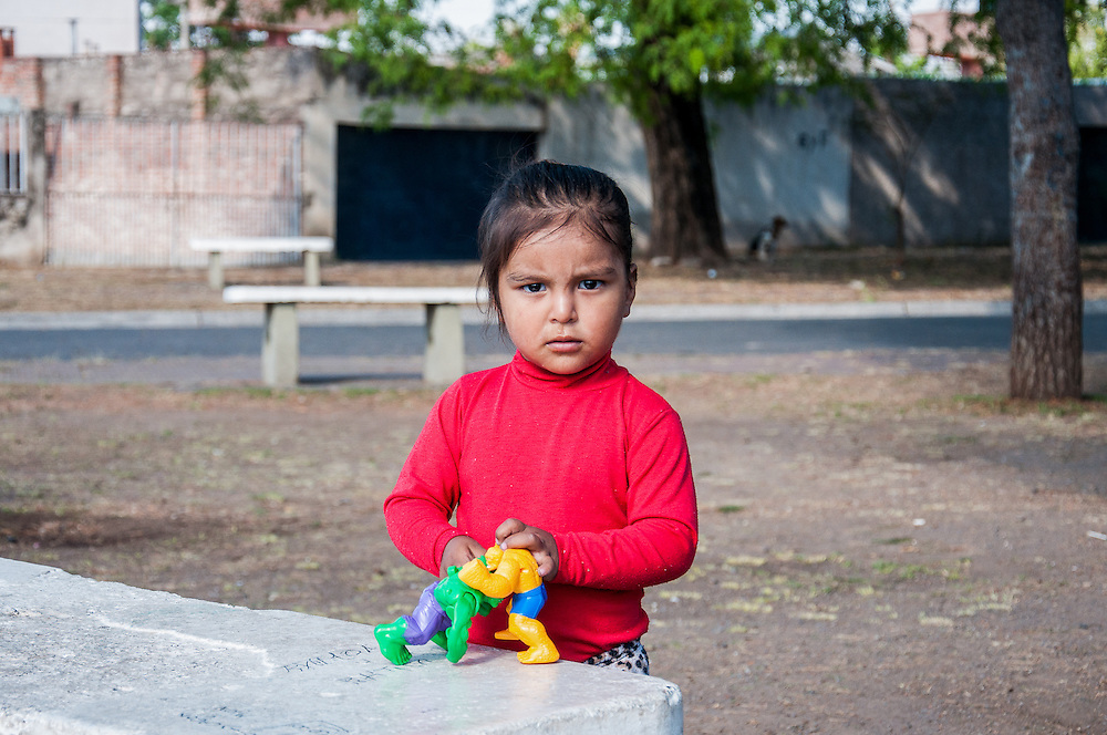 2014, Salta, Argentina. A girl plays alone in the streets of Salta.