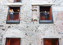 © Licensed to London News Pictures. 24/09/2018. Bristol, UK. The Bristol Old Vic Theatre in King Street reopens on Monday 24th September following a multi-million-pound transformation. Picture shows viewing platforms in part of the original wall of the theatre from 1766, 252 years old. The dramatic redevelopment, by leading theatre and Stirling prize-winning architects Haworth Tompkins, is designed to create a warm and welcoming venue to attract wider, more diverse audiences, and to place the theatre at the heart of the city's public and cultural life. A full-height timber and glass-fronted foyer, revealing the original auditorium façade to the street for the first time, acts like a covered public square. Huge sun-shading shutters, incorporating the text of Garrick's inaugural 1766 address and a poem by former Bristol city poet Miles Chamber, highlight the theatre's long history and look forward to its future role in the whole community. The internal layout of the theatre has also been completely transformed, with the restoration of the Georgian Coopers' Hall as a public assembly room for Bristol, a new studio theatre created in the old barrel vaults, mezzanine galleries, winding staircases and viewing platforms. Together, they provide new flexible spaces for productions, events, experimental theatre and city-wide participation. The Bristol Old Vic is the oldest continuously working theatre in the English speaking world. Photo credit: Simon Chapman/LNP