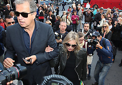 File photo : Kate Moss and Mario Testino attending Stella McCartney Spring-Summer 2013 Ready-To-Wear collection show, in Paris, France, on October 1, 2012. Photographer to the stars Mario Testino is a favourite of the Royal Family but he is facing a stream of sexual misconduct allegations from male models. Fashion brands Burberry and Michael Kors moved quickly to cut ties with him. He had been a front-runner to be the official photographer at the wedding of Prince Harry and Meghan Markle but has been ruled out following the uproar. Photo by ABACAPRESS.COM