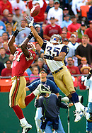 Rams' cornerback William Aeneas breaks up a pass in the end zone intended for 49ers' Terrell Owens in the fourth quarter at 3COM Park in San Francisco, Sunday, Sept. 23, 2001. The Rams won 30-26.