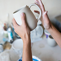 Laura Cooke of Cooke Ceramics at work on her porcelain ceramic pieces in her studio space at Clayspace. The Clayspace Co-op is a cooperative of professional ceramic artists located at the Wedge Studios at 119 Roberts Street in the River Arts District of Asheville, North Carolina.