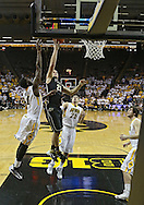 February 27 2013: Purdue Boilermakers guard/forward D.J. Byrd (21) puts up a shot around Iowa Hawkeyes center Gabriel Olaseni (0) during the first half of the NCAA basketball game between the Purdue Boilermakers and the Iowa Hawkeyes at Carver-Hawkeye Arena in Iowa City, Iowa on Wednesday, February 27 2013.