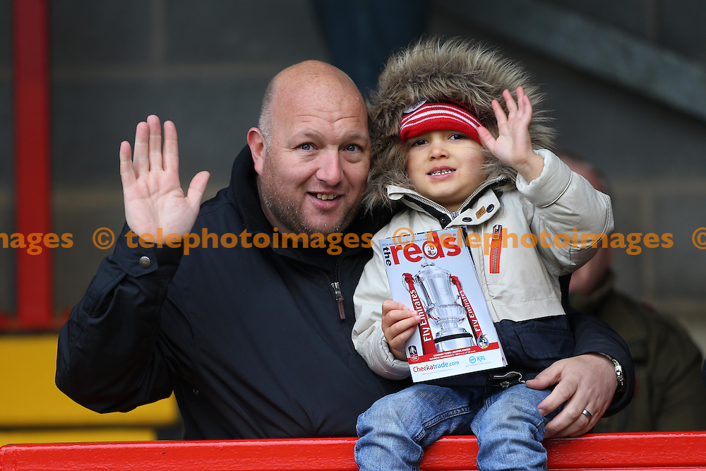 A young Crawley fan seen during the FA Cup match between Crawley Town and Bristol Rovers at the Checkatrade Stadium in Crawley. November 5, 2016.<br /> James Boardman / Telephoto Images<br /> +44 7967 642437