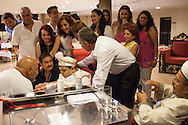 Families of the young participant eagerly watch the circumcision taking place in Kemal Özkan's Sünnet Sarayi in Istanbul, Turkey.
