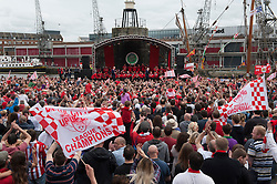 © Licensed to London News Pictures.  04/05/2015. Bristol, UK.  Bristol City FC celebration bus tour of the city to celebrate their double, winning League One and promotion to the Championship and the Johnston's Paint Trophy this season.  The buses left City's ground at Ashton Gate and paraded through the city to the Lloyds Amphitheatre in the city docks to crowds cheering and waving flags.  Photo credit : Simon Chapman/LNP