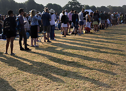 People queuing in Wimbledon Park on day four of the Wimbledon Championships at the All England Lawn Tennis and Croquet Club, Wimbledon.