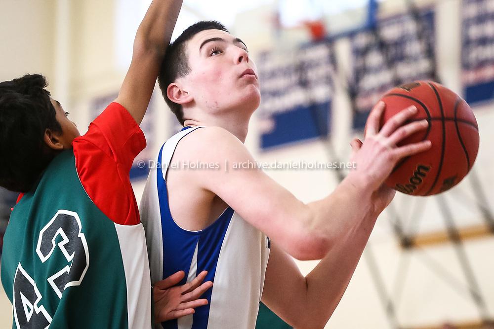 (2/1/15, ASHLAND, MA) Brendan Petry (#11) plays basketball at Ashland High School on Sunday. Photo by Dan Holmes