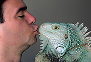 """Henry Lizardlover 7, and yes, that's his real name after legally changing it, smooches 16 pound """"Hasbro""""! He has several dozen iguanas at home."""