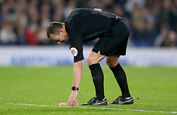 EDITORS NOTE: EXPLICIT CONTENT<br /><br />Referee Kevin Friend picks up a dildo that was thrown on to the pitch during the match