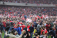 Middlesbrough FC fans celebrate promotion at the end of the Sky Bet Championship match between Middlesbrough and Brighton and Hove Albion at the Riverside Stadium, Middlesbrough, England on 7 May 2016.