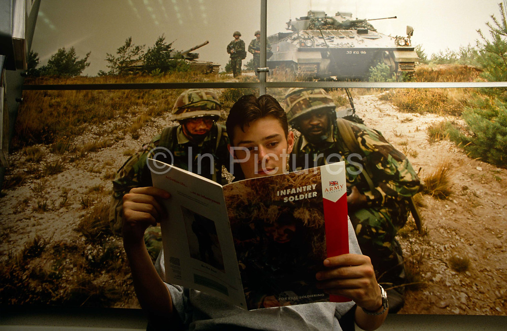 A young man who is interested in joining the British army has dropped in to a recruiting office in Central London. Sitting in front of an action picture of serving soldiers already living their own adventurous dream for Queen and country. They are on manoeuvres with a tank and others in support from the same platoon in the background. The lad is reading every word a brochure published by the Ministry of Defence (MoD) called Infantry Soldier which will give him the facts about the job and answer his questions regarding a new career. With squeezes on the budgets for supplying servicemen's equipment, this young recruit may not find realities of life in the armed services as idyllic as is suggested on paper.