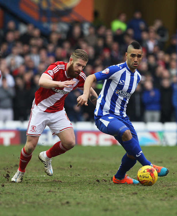Middlesbrough's Adam Clayton (L) and Sheffield Wednesday's Lewis McGugan in action during todays match  <br /> <br /> Photographer Jack Phillips/CameraSport<br /> <br /> Football - The Football League Sky Bet Championship - Sheffield Wednesday v Middlesbrough - Saturday 28th February 2015 - Hillsborough - Sheffield<br /> <br /> © CameraSport - 43 Linden Ave. Countesthorpe. Leicester. England. LE8 5PG - Tel: +44 (0) 116 277 4147 - admin@camerasport.com - www.camerasport.com