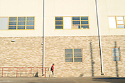 A student walks to school at Sam Tasby Middle School in Dallas, Texas on October 2, 2014. Officials confirmed that a student at Sam Tasby Middle School had come in contact with the first confirmed Ebola virus patient in the United States. (Cooper Neill for The New York Times)