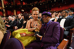 Tonya Lewis Lee and Spike Lee pose with the Oscar® for adapted screenplay during the live ABC Telecast of The 91st Oscars® at the Dolby® Theatre in Hollywood, CA on Sunday, February 24, 2019.