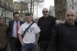 March 29, 2019 - London, Greater London, United Kingdom - The right-wing leader Tommy Robinson (centre), whose real name is Stephen Yaxley-Lennon, seen leaving the.Make Brexit Happen stage in Whitehall after addressed a speech to his supporters...A Leave means leave pro Brexit march begun on March 16 in Sunderland, UK and ended with a rally in Parliament Square on March 29 in London, same day that UK has been scheduled to leave the European Union. Pro Brexit protesters gathered at Parliament Square to demand from the government to deliver what was promised and leave the European Union without a deal. Nigel Farage and Tommy Robinson were seen giving speeches to their supporters in different stages during the pro Brexit protest. (Credit Image: © Andres Pantoja/SOPA Images via ZUMA Wire)