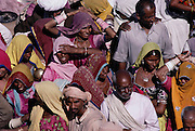 Pilgrims at Kumbh Mela. Every 12 years, millions of devout Hindus celebrate the month-long festival of Kumbh Mela by bathing in the holy waters of the Ganges at Hardiwar, India. Hundreds of ashrams set up dusty, sprawling camps that stretch for miles. Under the watchful eye of police and lifeguards, the faithful throng to bathe in the river.