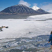 Nunavut, Canada. Inuit tour guide descent glacial moraine on Bylot Island, north of Baffin Island.