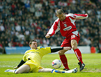Photo: Chris Ratcliffe.<br />Leyton Orient v Peterborough United. Coca Cola League 2. 29/04/2006.<br />Lee Steele (R) of Orient tries to a shot in as Mark Arber of Peterborough tries to stop him from the floor.