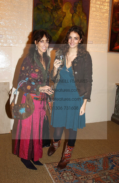 Left to right, MRS TIM HANBURY and her daughter MISS ROSE HANBURY at an exhibition of recent work by artist Lance Tilbury held at the Old Imperial Laundry, Warriner Gardens, Battersea, London on 7th December 2004.<br /><br />NON EXCLUSIVE - WORLD RIGHTS