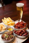 Belo Horizonte_MG, Brasil.<br /> <br /> Detalhes de pratos servidos na choperia Albanos no Bairro Anchieta em Belo Horizonte. Na foto Carne de sereno, linguica ao cacador, costelinha defumada, mandioca e fritas.<br /> <br /> Details of foods served in Alban taproom in the neighborhood Anchieta in Belo Horizonte.<br /> <br /> Foto: JOAO MARCOS ROSA / NITRO