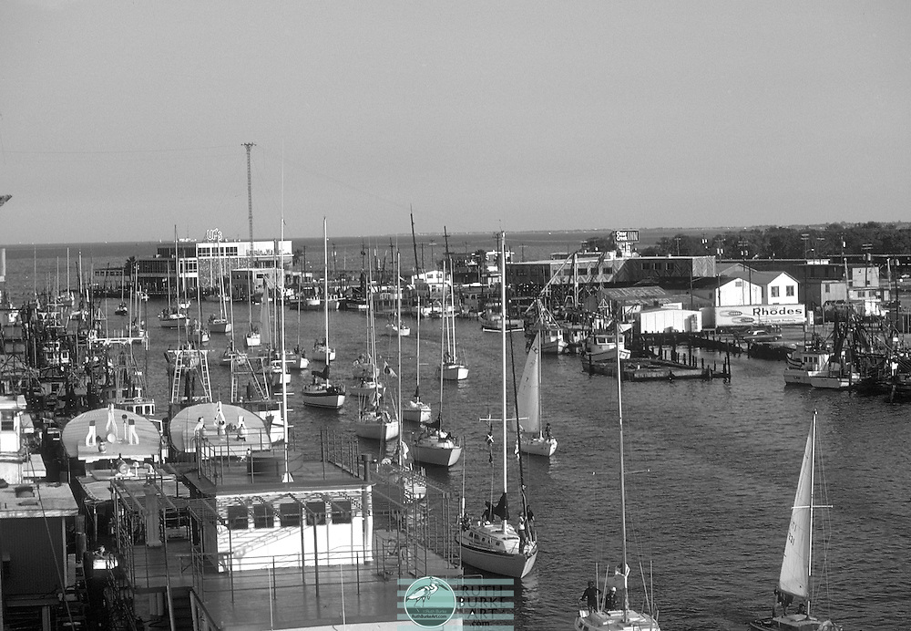1980 Clear Creek Channel with sail boats waiting for the draw bridge to open in Kemah and Seabrook, Texas waterfront.  Horizontal view