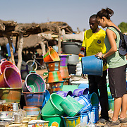 Peace Corps volunteer Rachael goes bucket shopping at the Sunday market near her village of Koumbadiouma. Kolda, Senegal.
