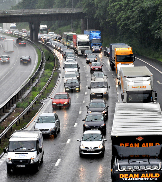 © Licensed to London News Pictures. 06/072012. Stoke, UK. Heavy  traffic on the M6 north bound at junction 15 near Stoke on Trent following heavy rainfall on July 6, 2012. Rain has caused chaos and localised flooding across many part of Staffordshire today. Photo credit : Rob Leyland/LNP